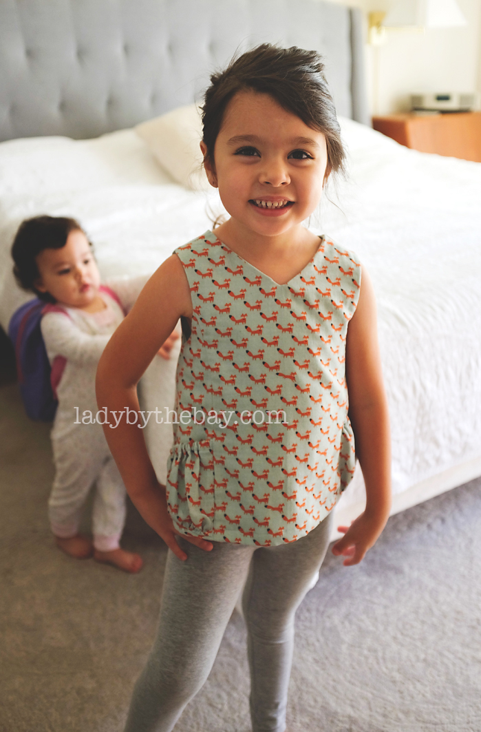 My sweet granddaughter modeling her new top :)