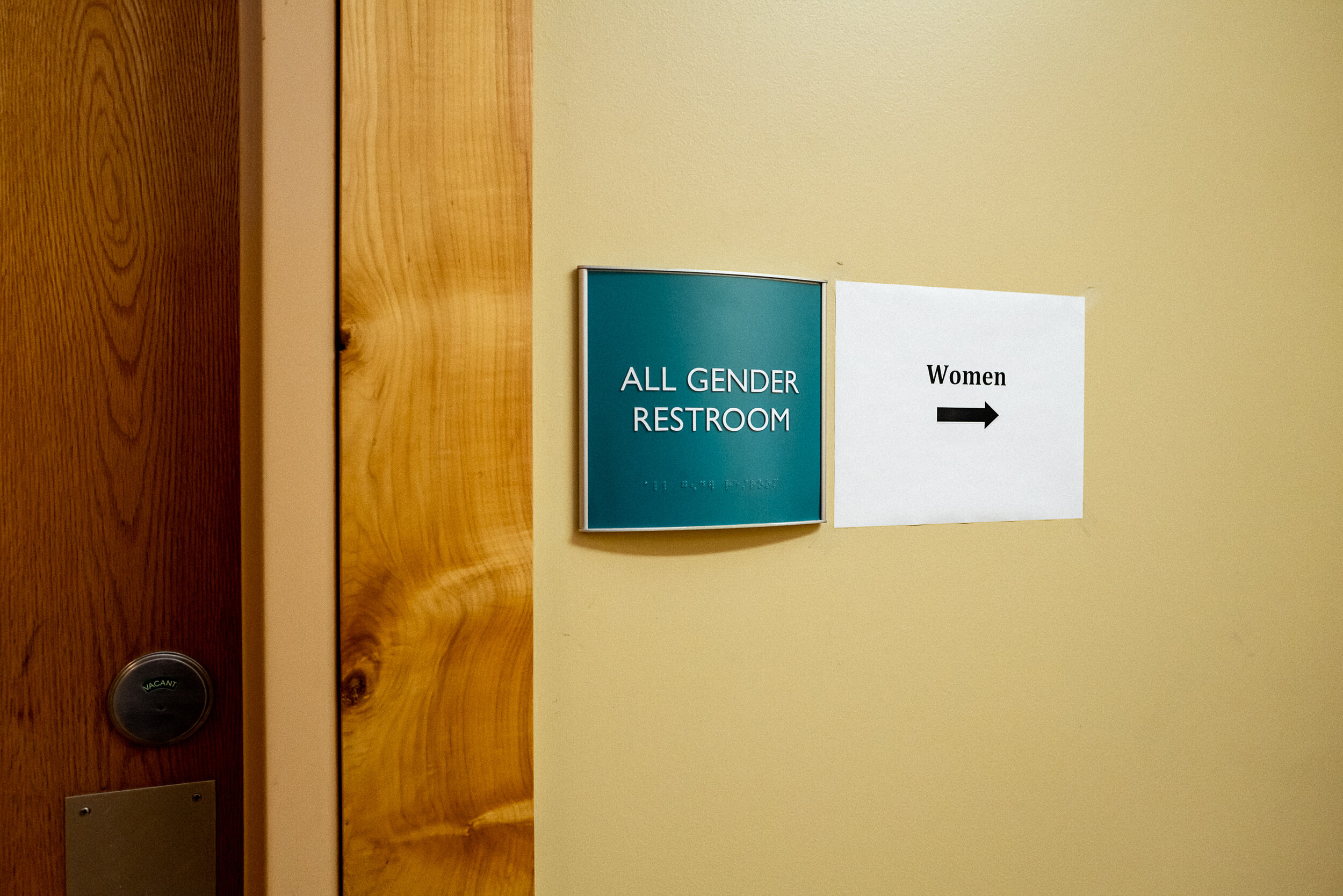 """""""When I first started asking people to use 'They/Them' pronouns with me, most of my friends said they had seen it coming for a long time and weren't surprised. They were like, 'Yes! Finally!'."""" The restroom outside of Ray's workplace."""