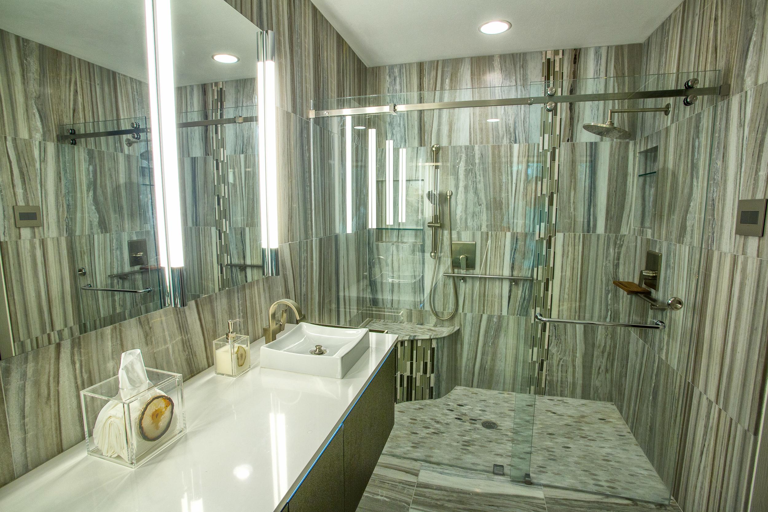 Designer master bathroom with beautiful marble walls