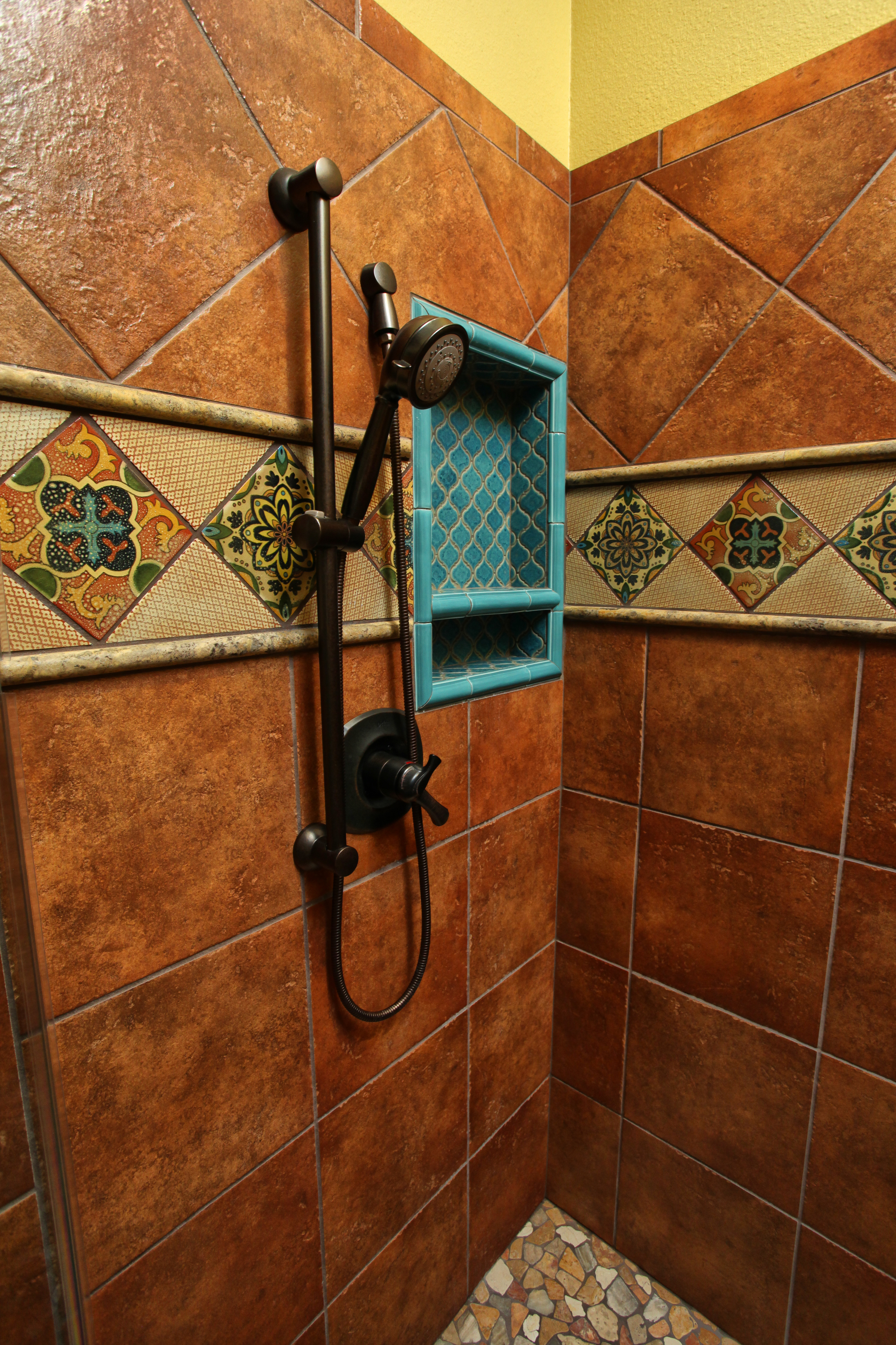 Mexican tile, pebble flooring, and Arabesque tile in southwest master bath remodel