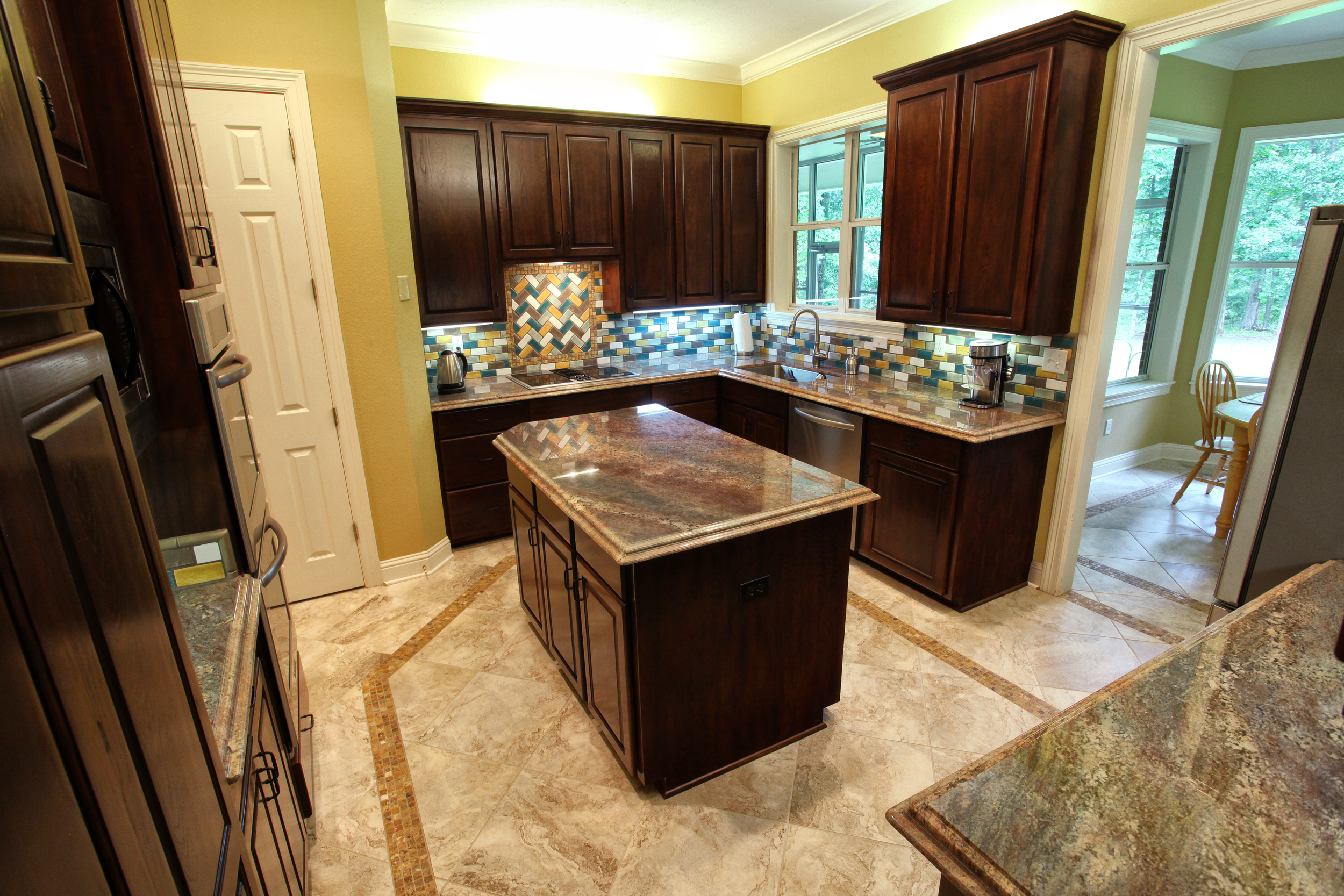Mexican tile and granite countertops - Texas Interior Design
