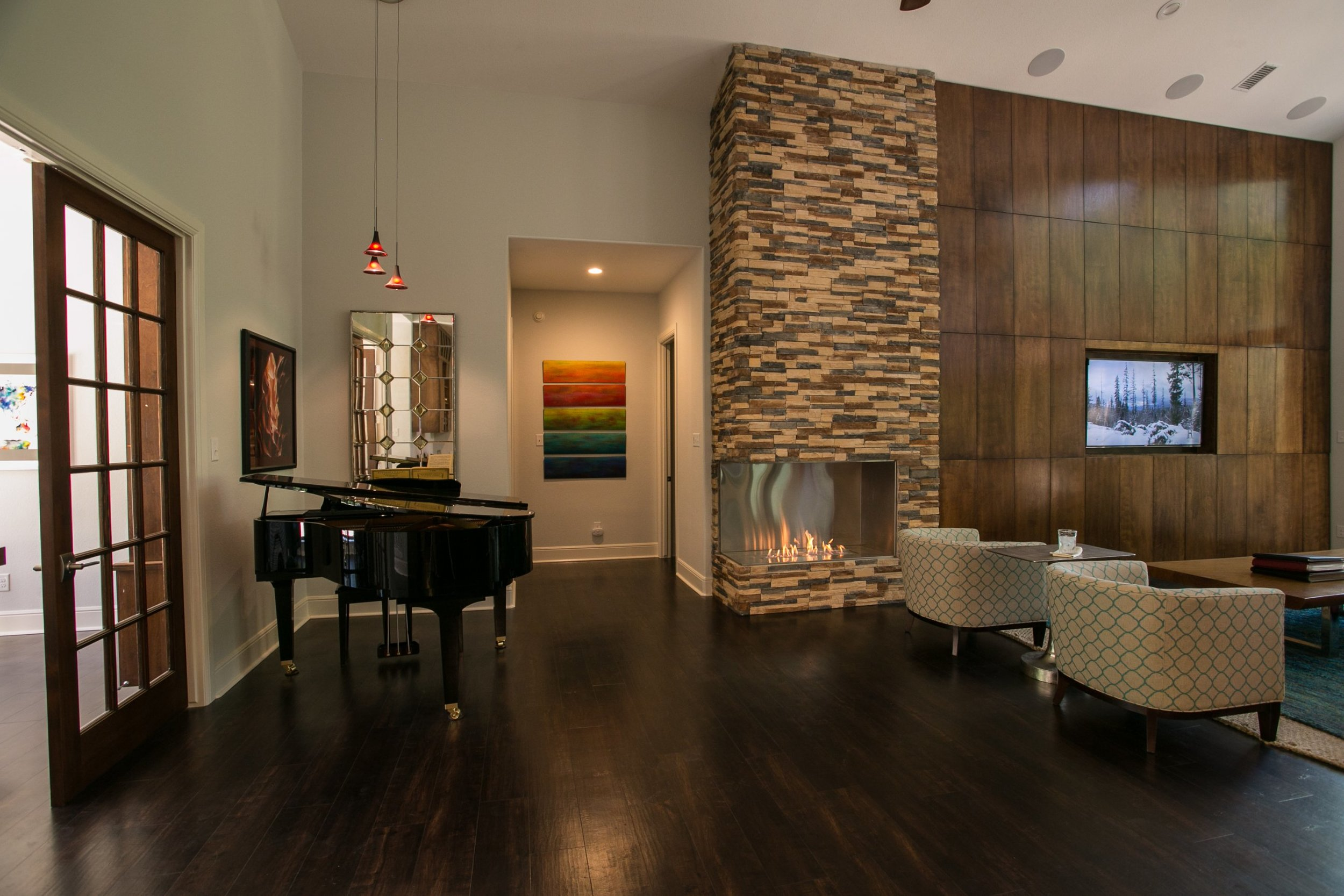 The rock fireplace goes to the ceiling in this contemporary lodge home