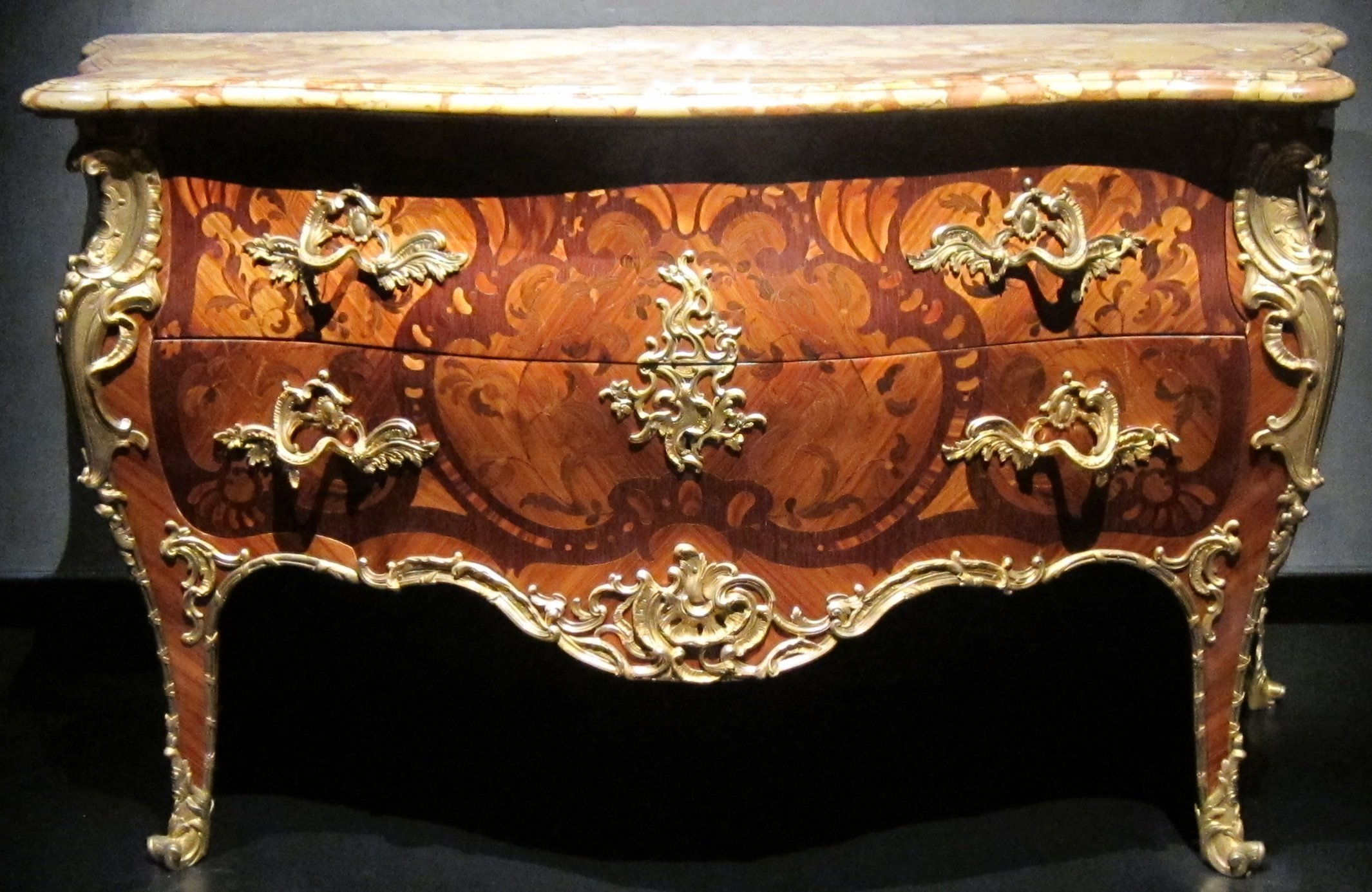 Note how the marble complements but does not distract from the Louis XV commode.