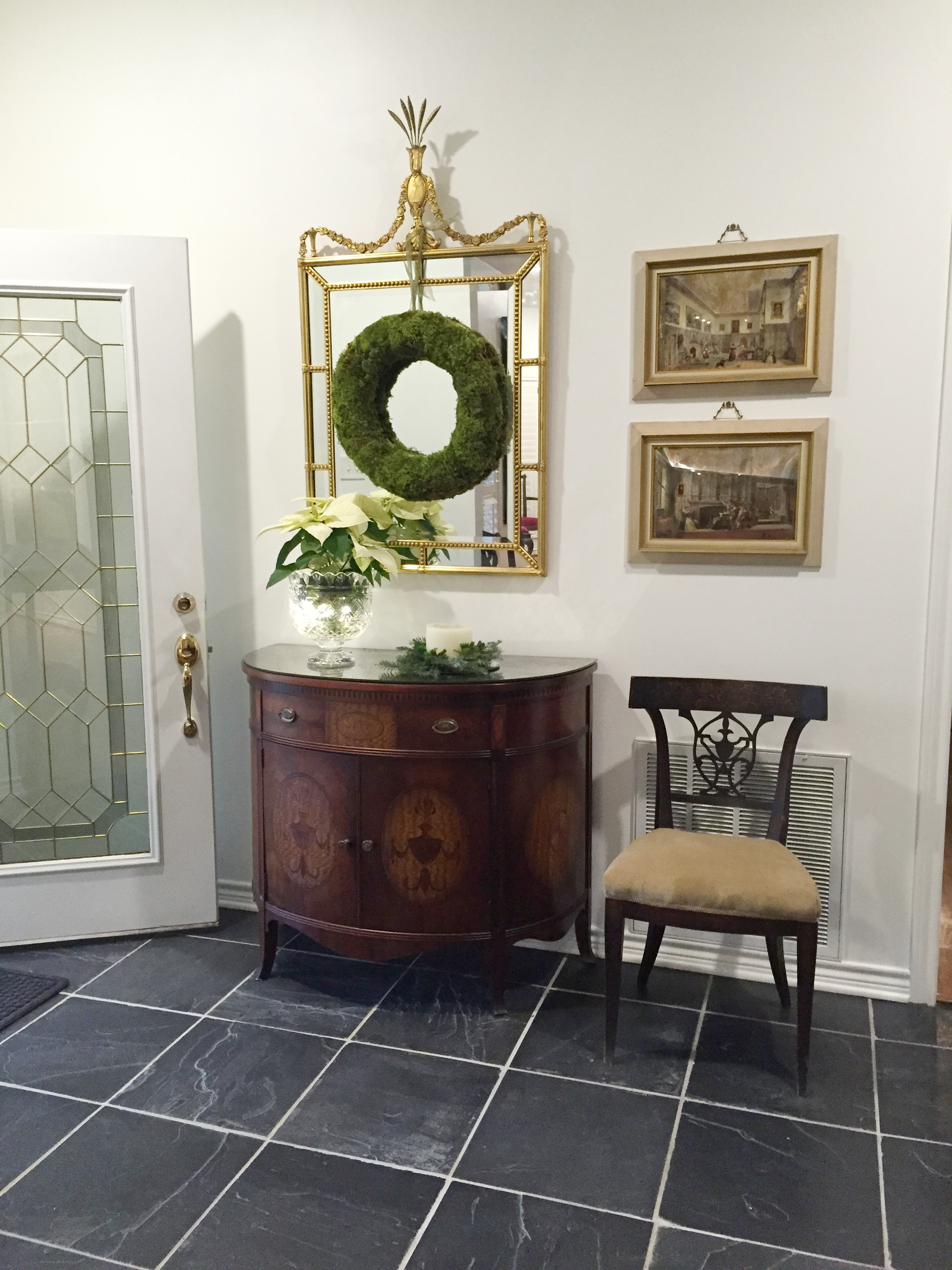 A demi-lune console and gilded mirror from Mama Rene's house are now at home in our foyer.