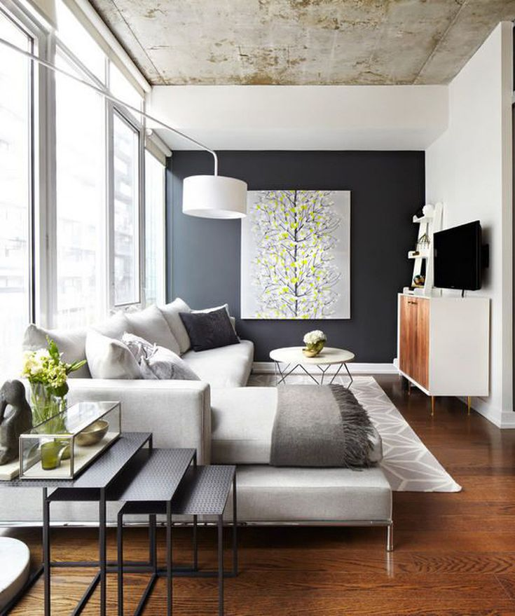 """The """"floating chaise"""" of this sectional helps visually divide this long narrow living room."""