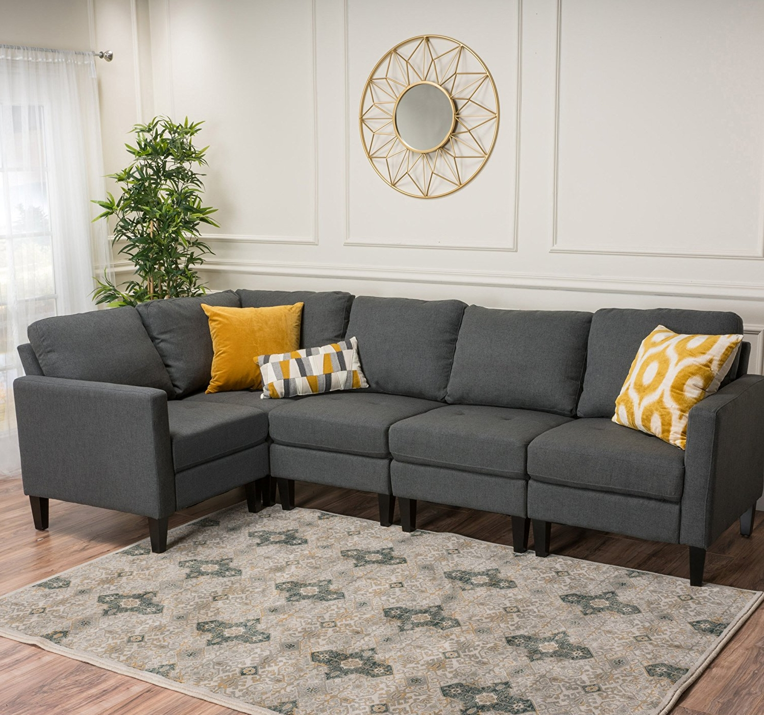 This small sectional with floating chair L is available through this  affiliate link .