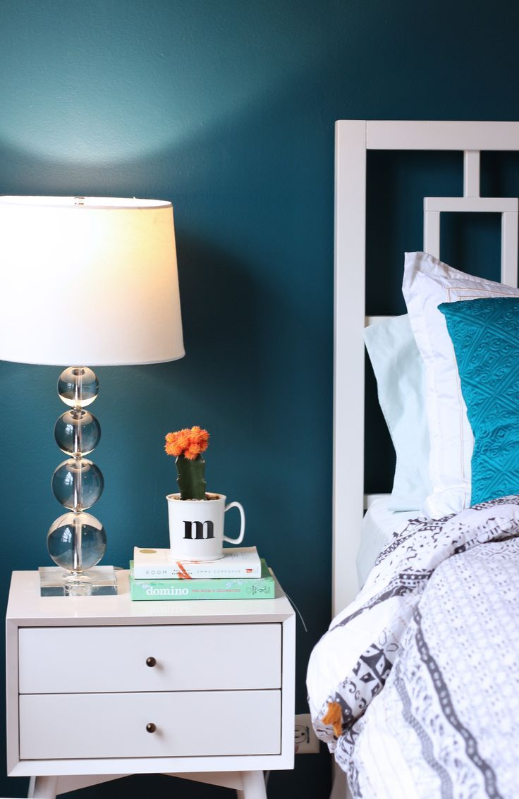 Benjamin Moore's Galapagos Turquoise is a perfect tone for a bedroom.  I recently used it as an accent on a kitchen island.