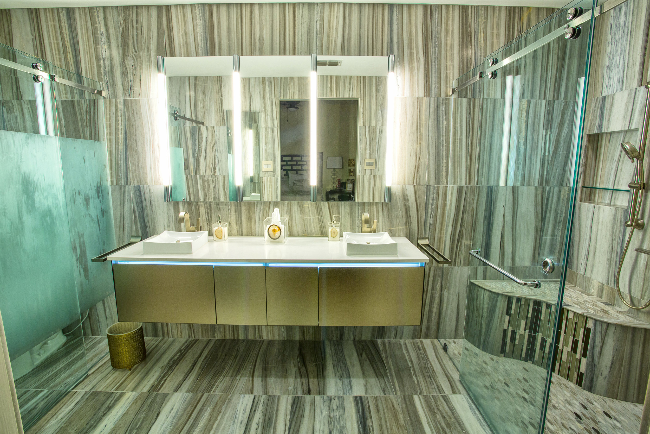 AFTER - Fabulous lighting on either sides of mirrored medicine cabinets in our redesigned bathroom.