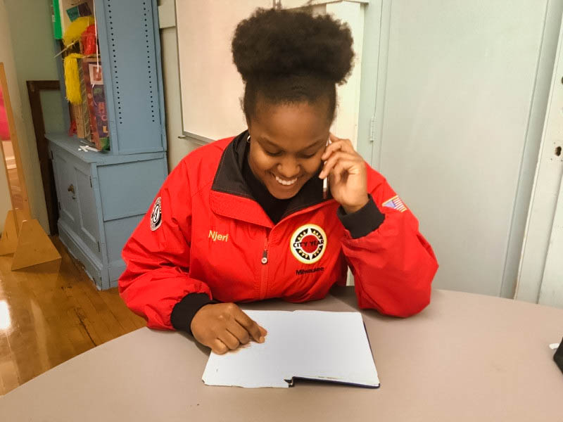 11am Phone Calls Home: When students are absent or show positive behavior, corps members call home to check on them and share a child's success with their family.