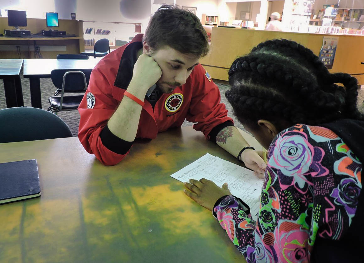 "9:15am Interventions: In addition to supporting in the classroom, corps member have a list of about six students they specifically work with academically. These students are called their ""focus list."" Everyday, corps members do small group interventions or one-on-one tutoring with these students, focusing on strengthening their math and/or English language art skills."