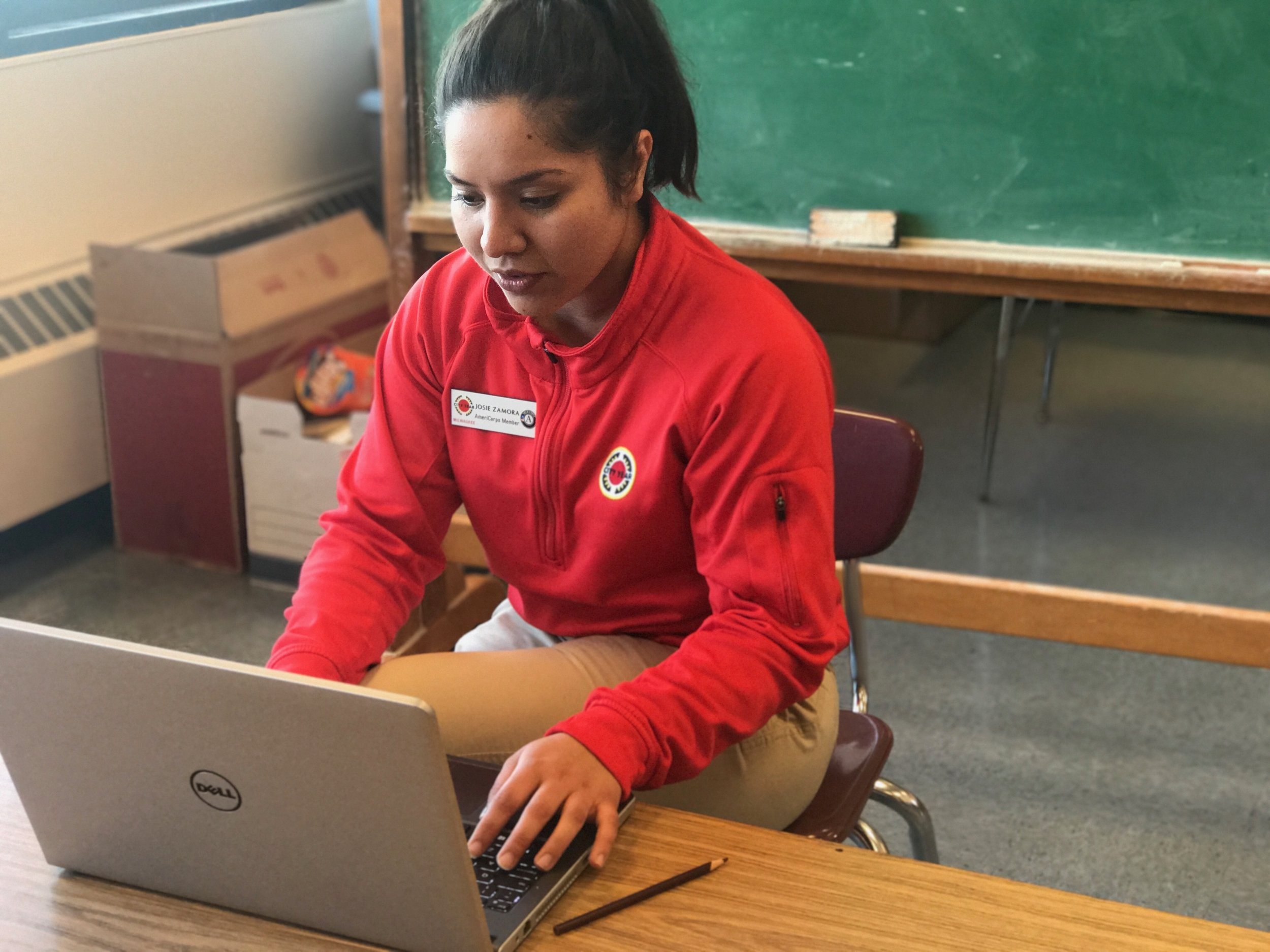 "1:30pm Coordinator Role: Every corps member is assigned a ""Coordinator Role."" There are monthly meetings where corps members learn about updates and projects related to their role. Afterwards, they share this information with their team. Josie is an Events and External Affairs coordinator and is working on writing her team's newsletter that goes to community sponsors."