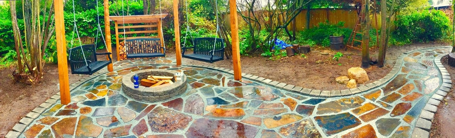 Flagstone patio featuring a Roman stack border and a 1/4 minus gravel fill.