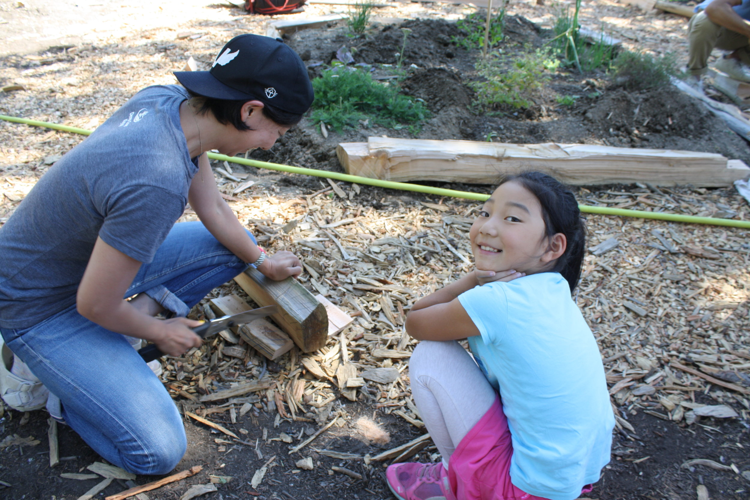 Hard at work creating herb garden borders out of reclaimed wood!
