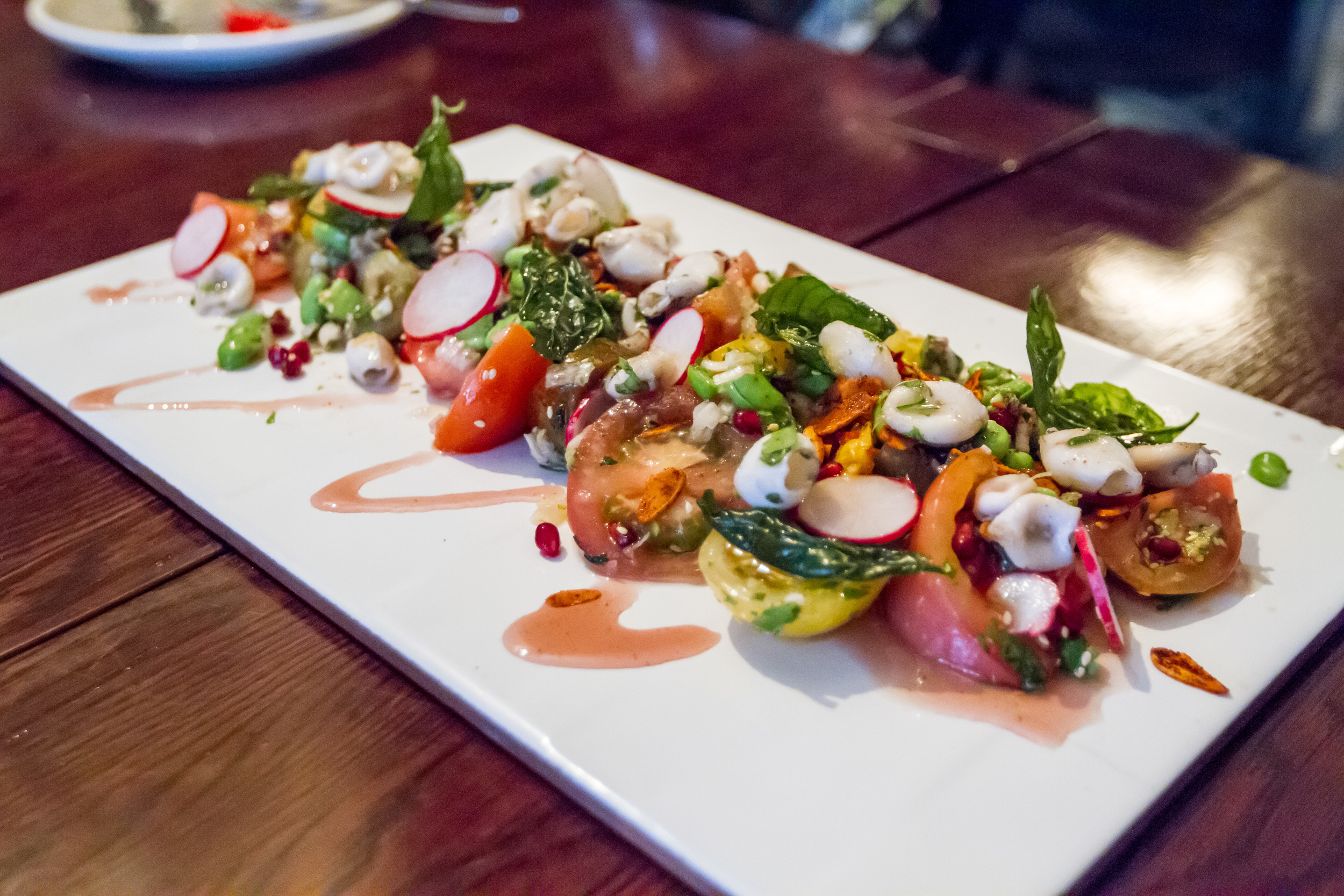 isle of wight herloom tomato and squid salad at nomad.jpg