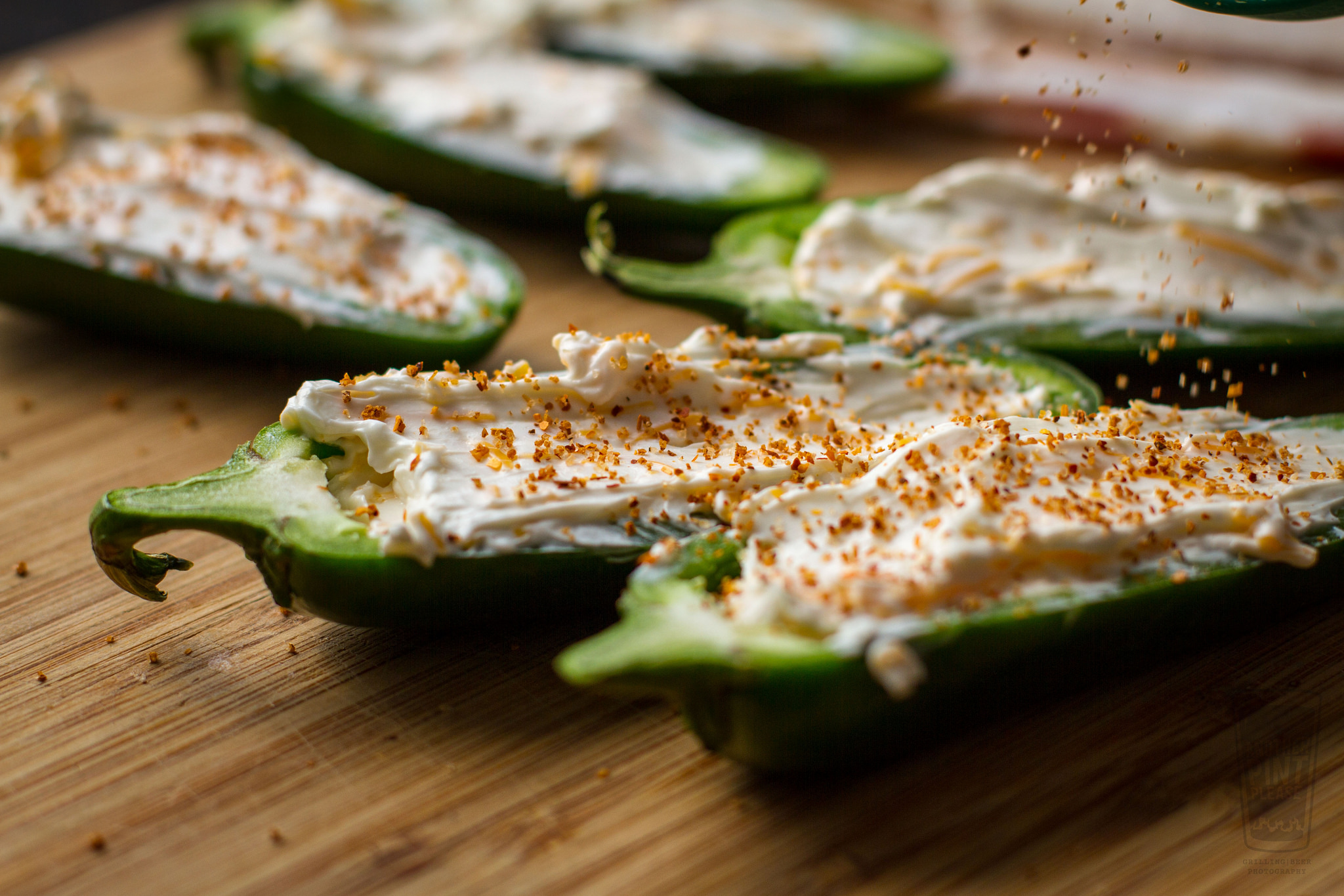 sprinkling rub on jalapeno poppers.jpg