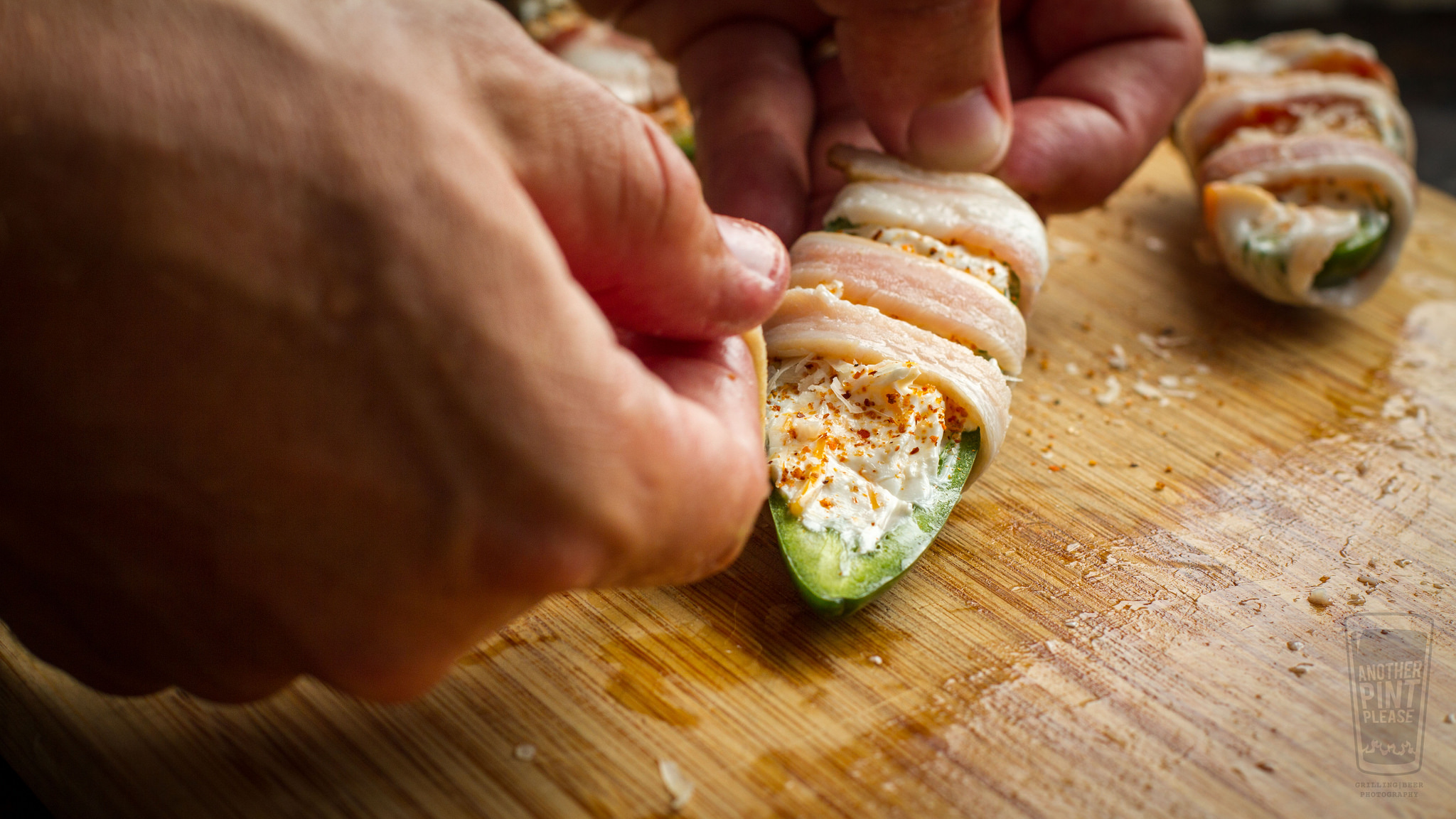 wrapping bacon around jalapeno popper.jpghttps://www.flickr.com/photos/anotherpintplease/28334237580