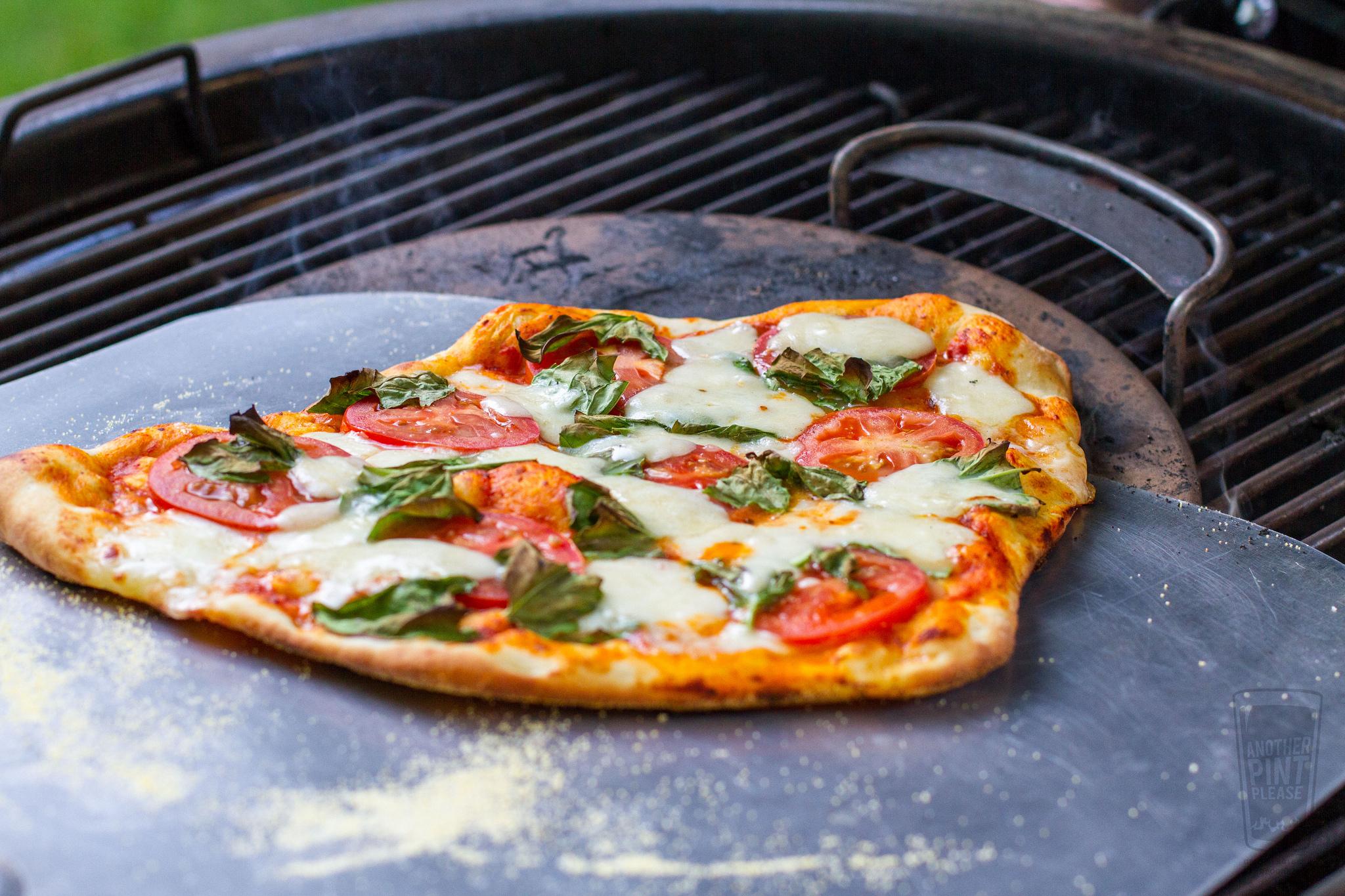 sliding pizza off of pizza stone.jpg
