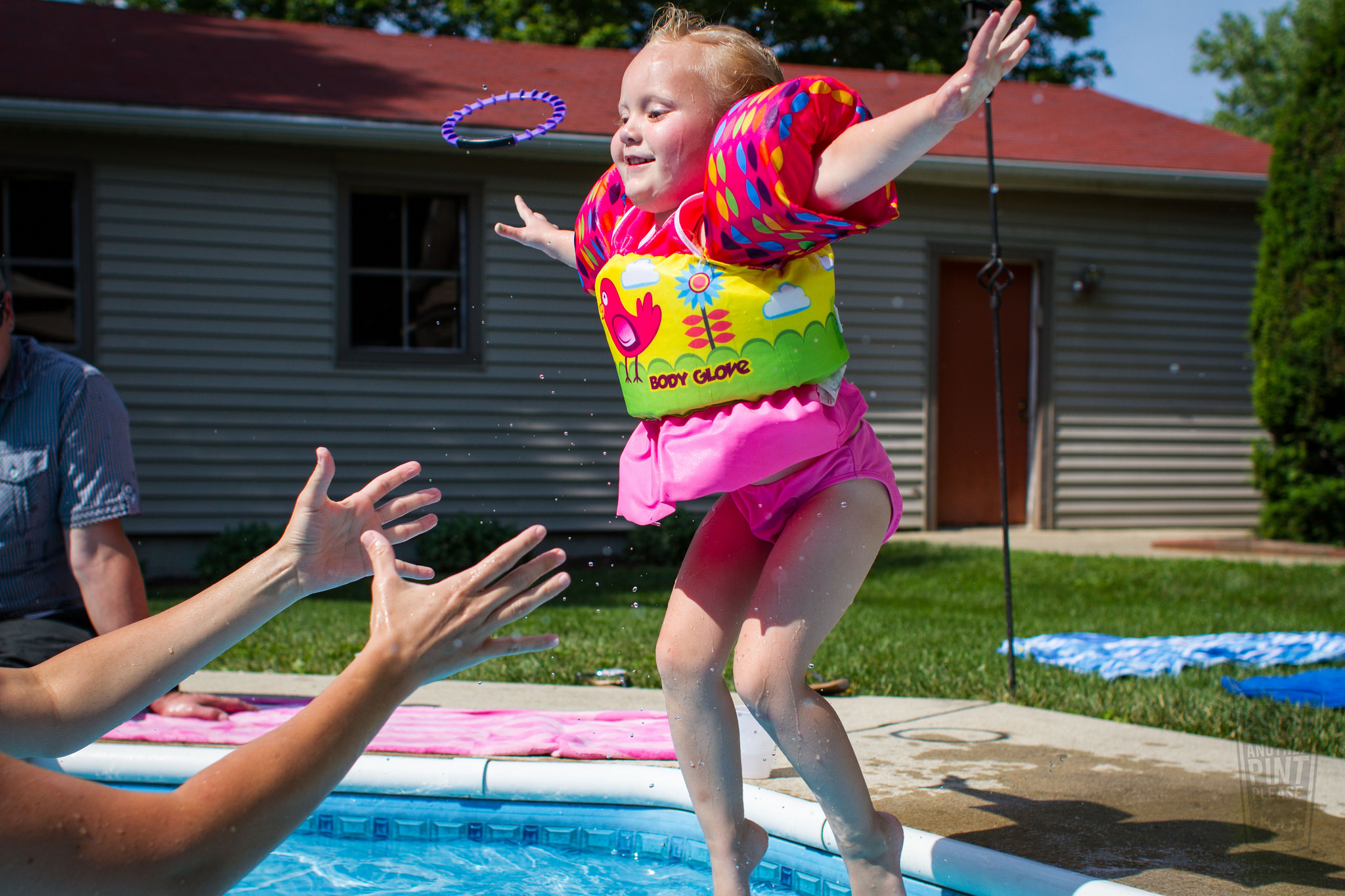 jumping into pool with water wings.jpg