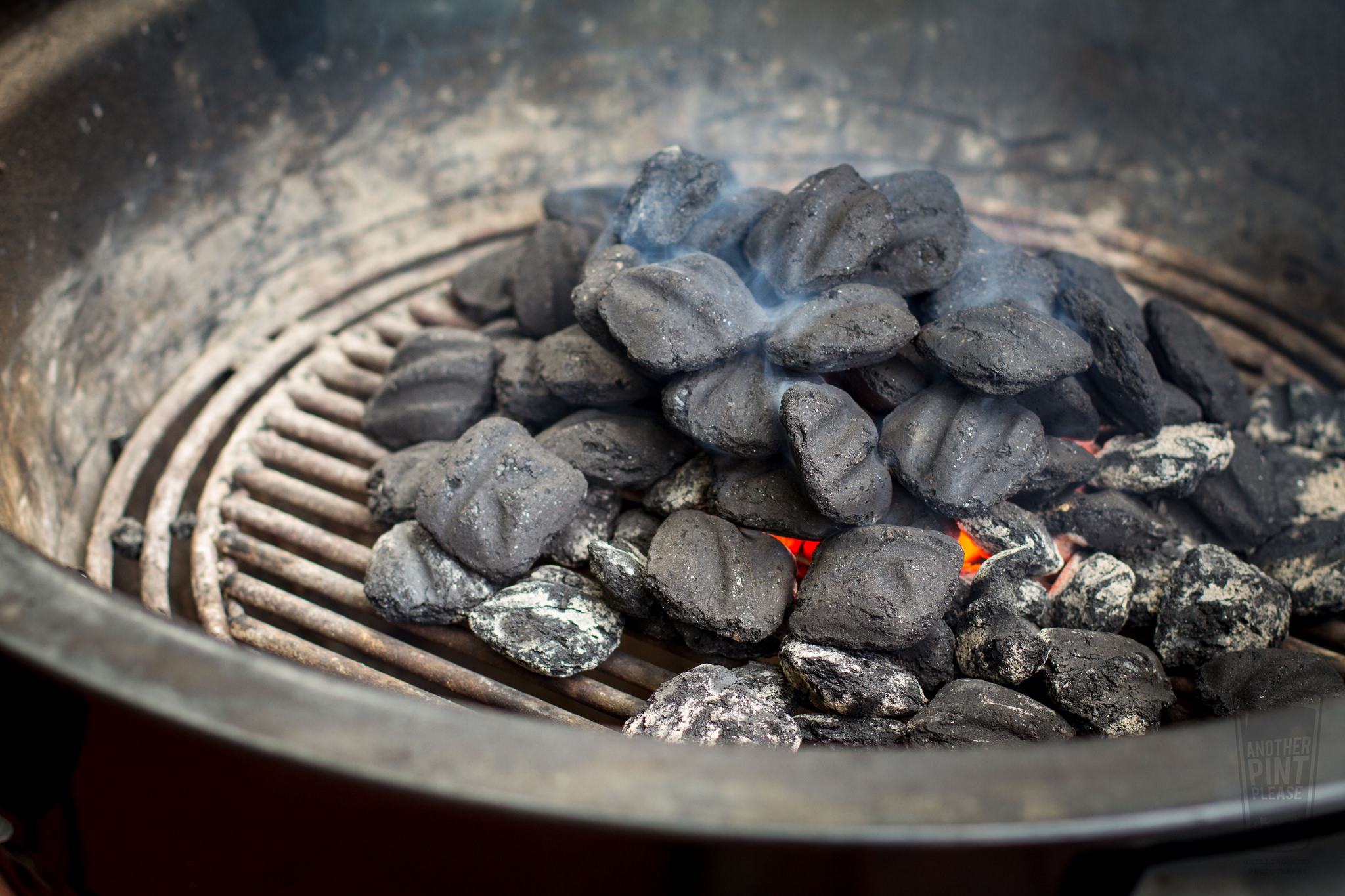 lit charcoal on weber summit charcoal grill.jpg
