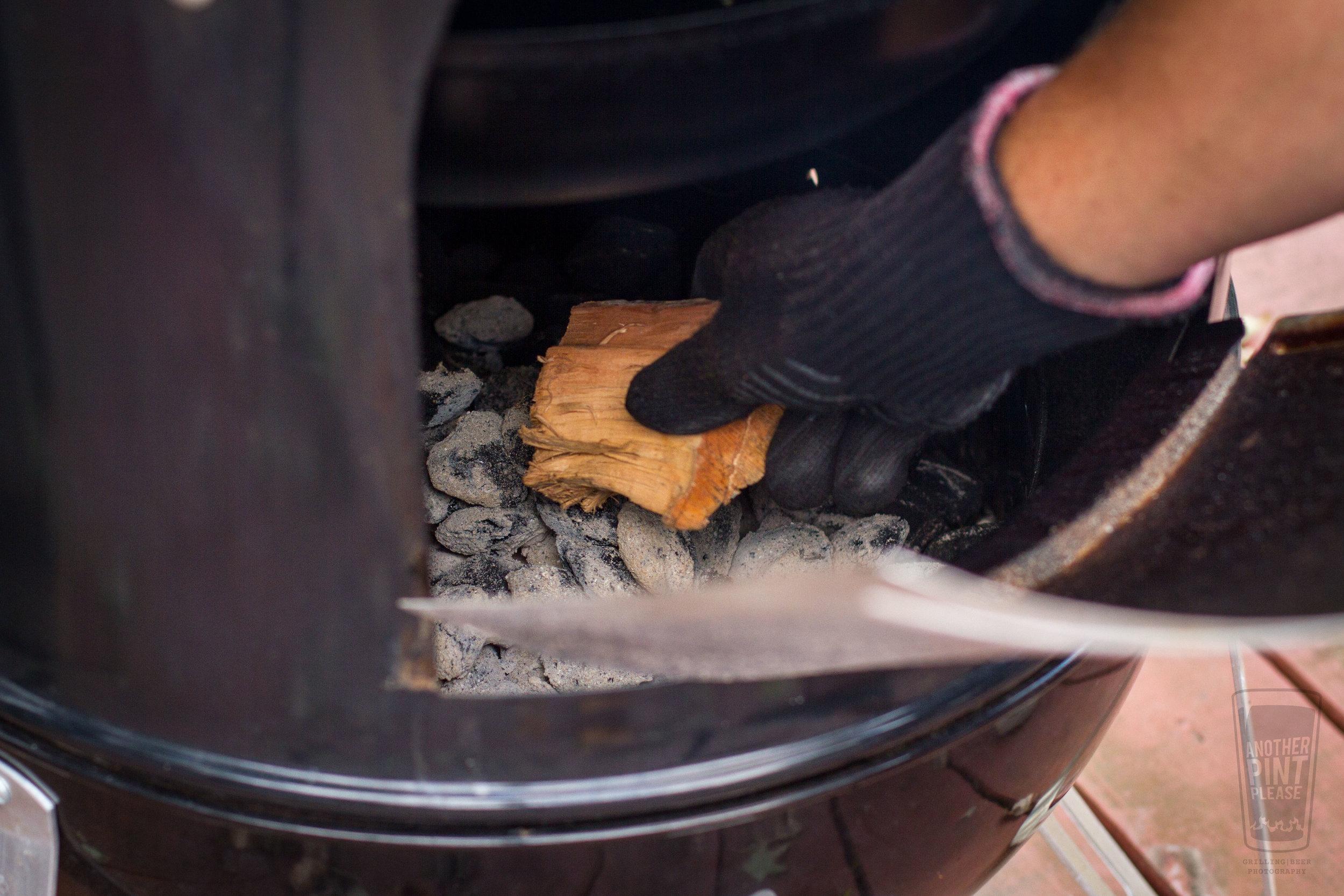 placing wood chunks in smoker.jpg
