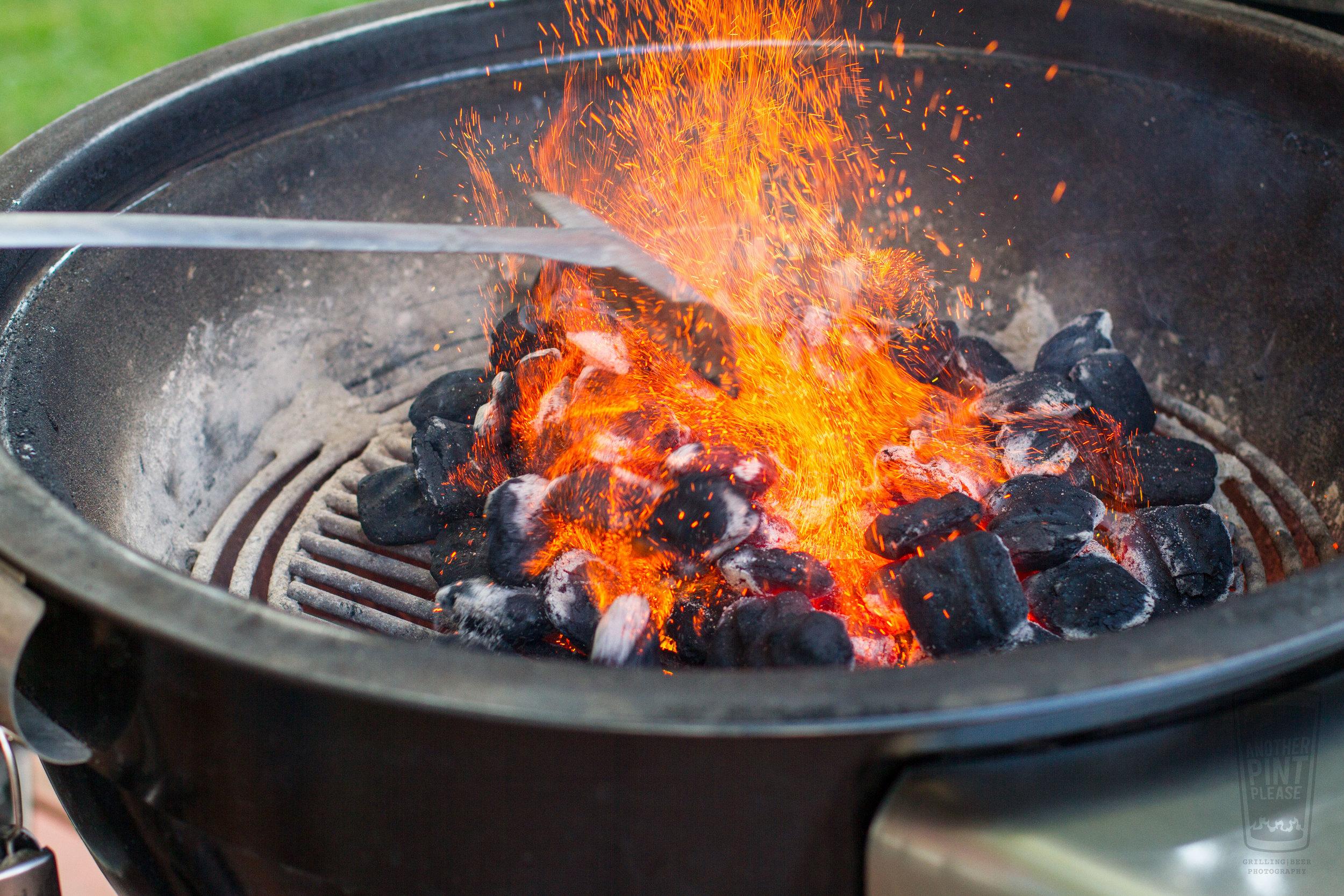raking coals on weber summit charcoal grill.jpg