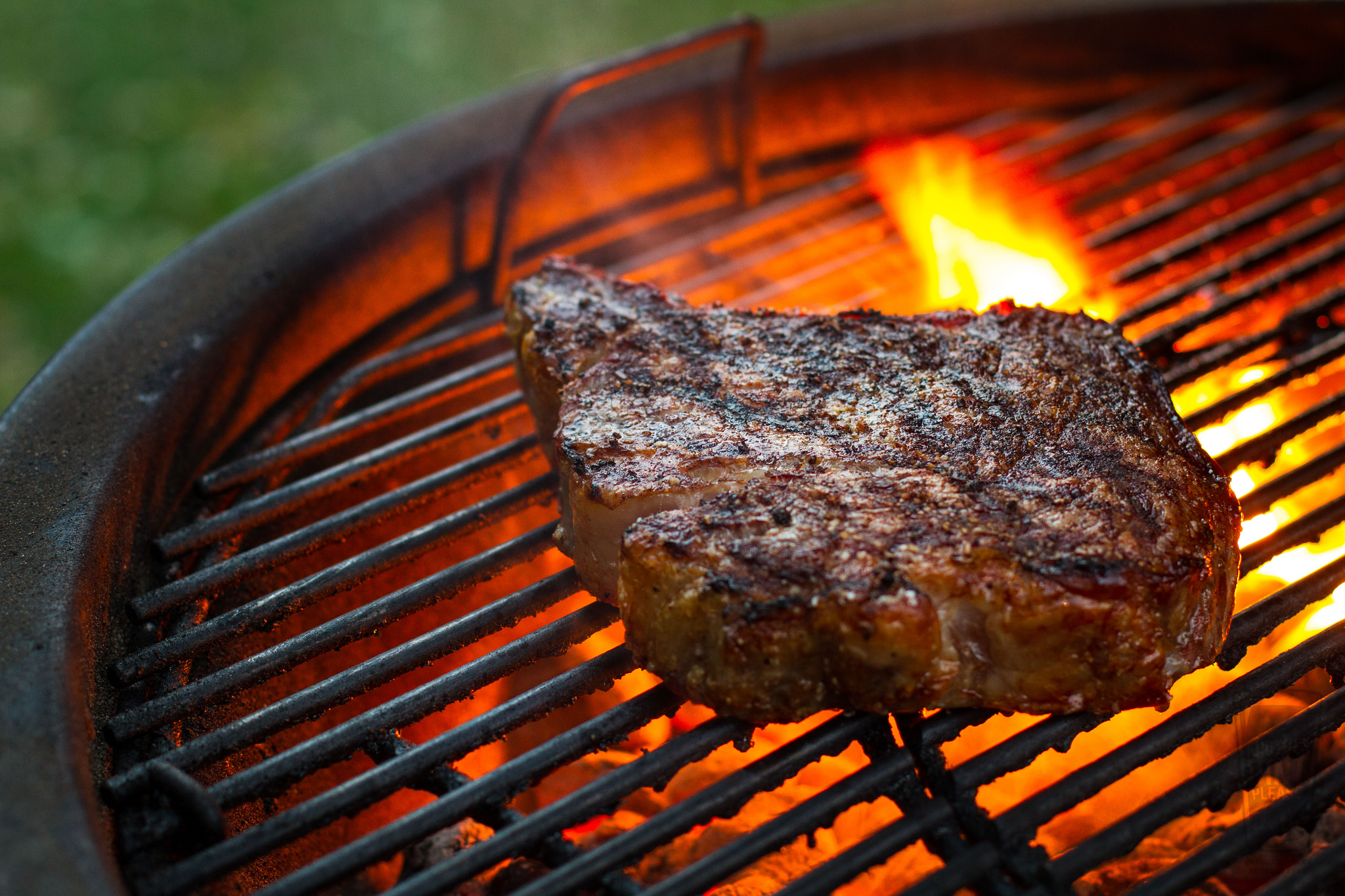 grilled steak on weber summit charcoal grill.jpg