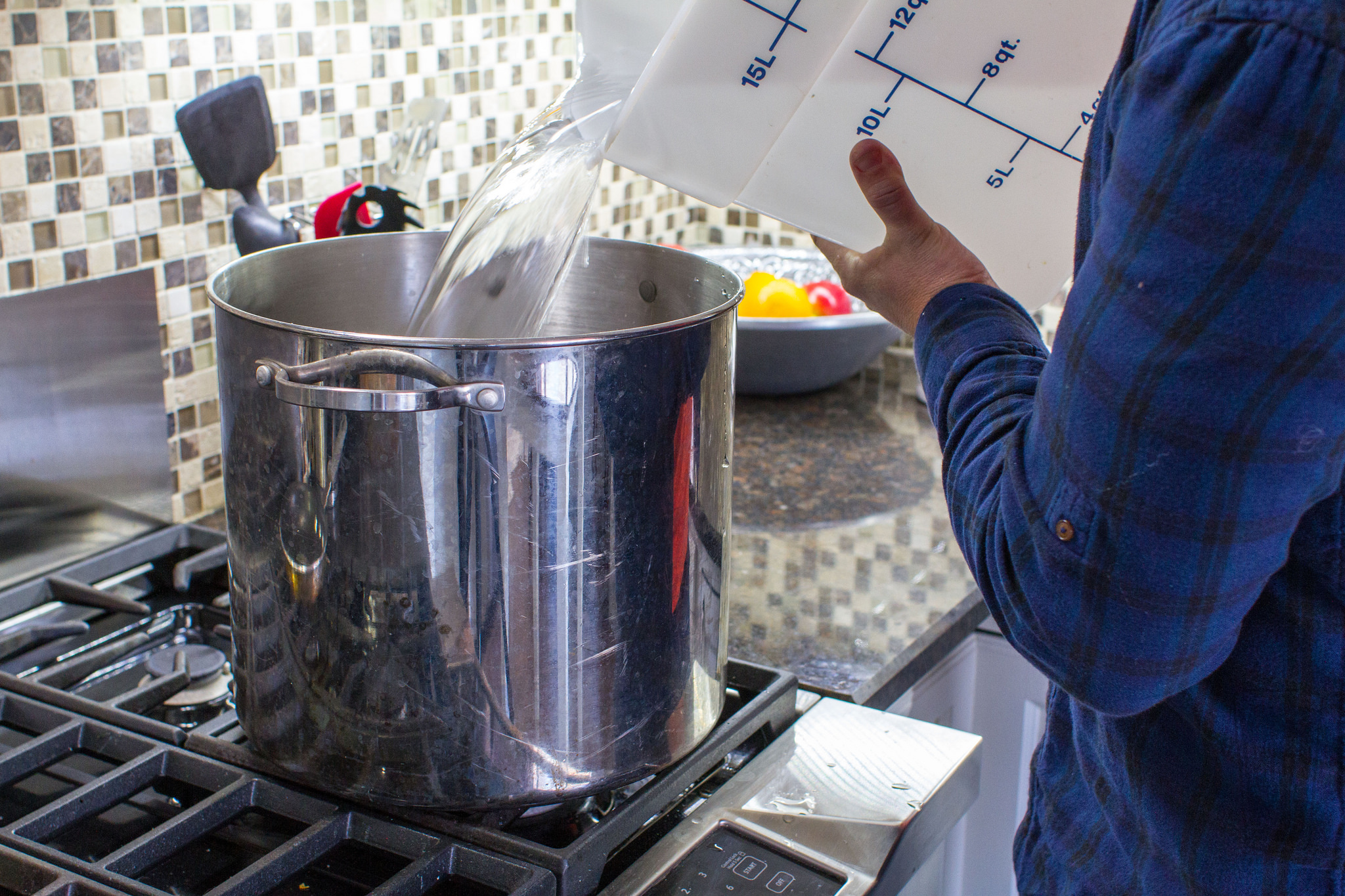 pouring water into stockpot.jpg