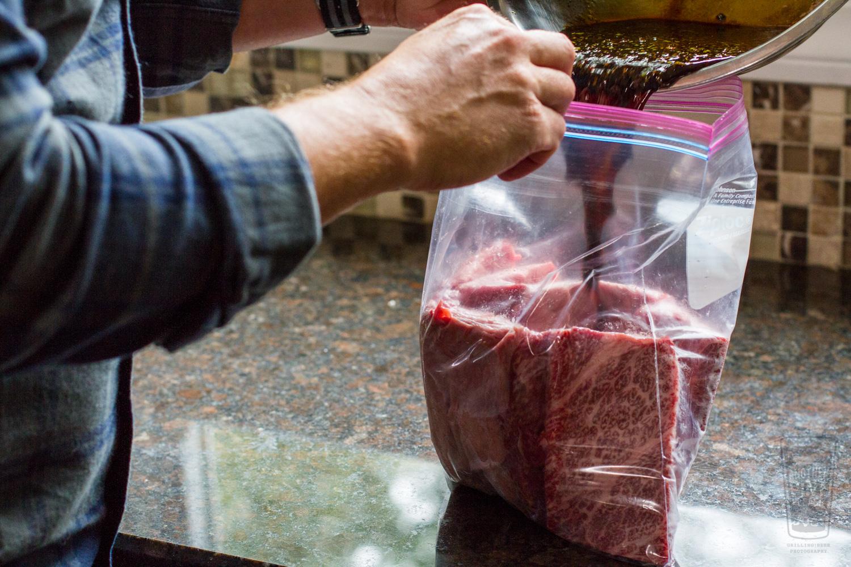 Adding marinade to bag