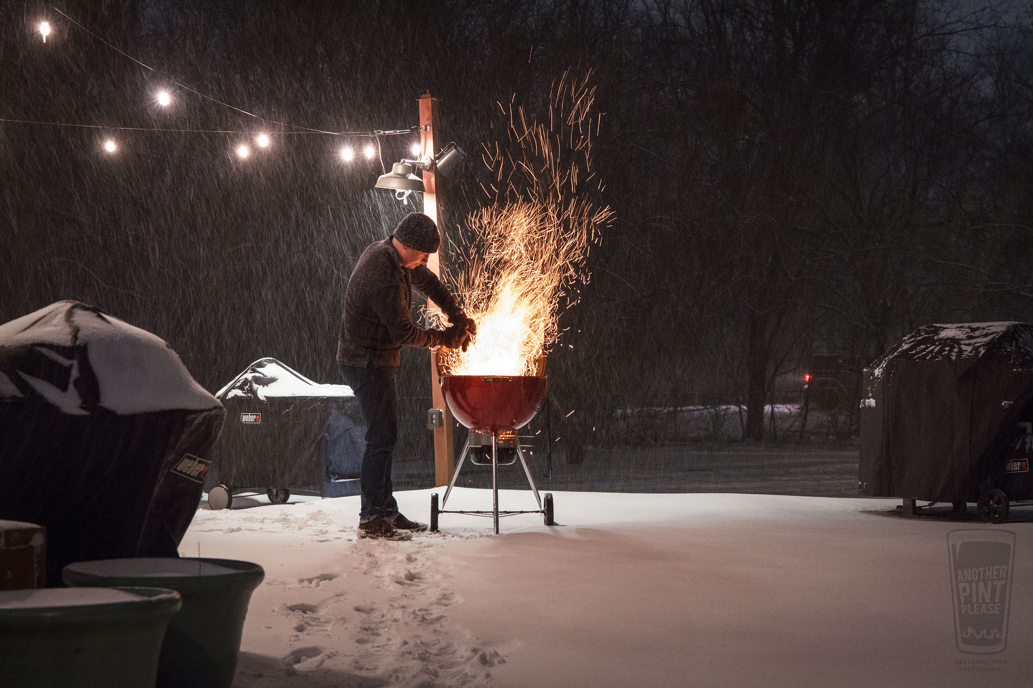 charcoal dump in snow in weber red kettle grill.jpg