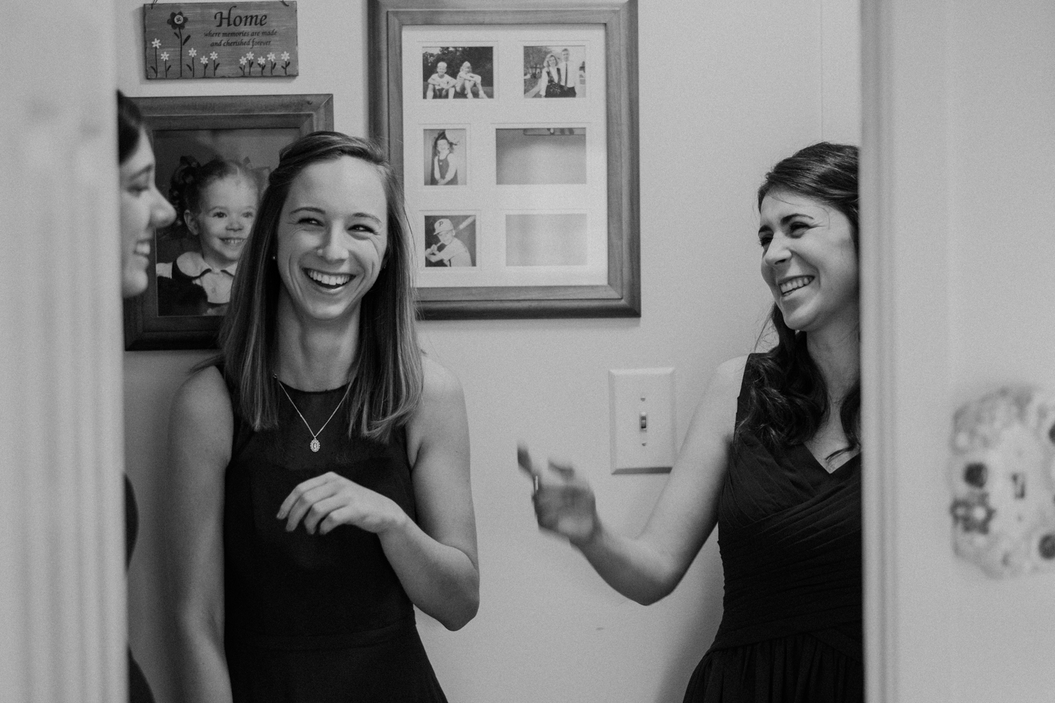 candid bridesmaids laughing getting ready