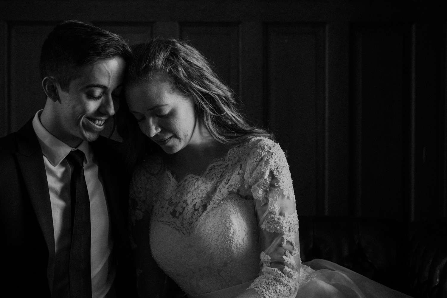 intimate bride and groom black and white moment