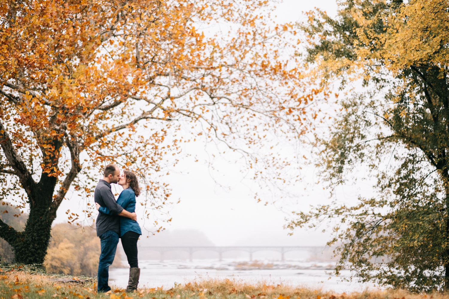 engagement picture looking out at the potomac river in harpers ferry