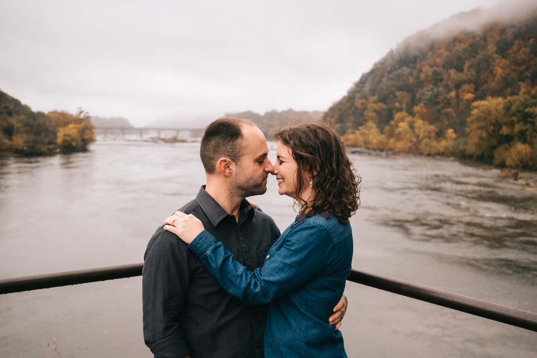 autumn engagement photo potomac river harpers ferry