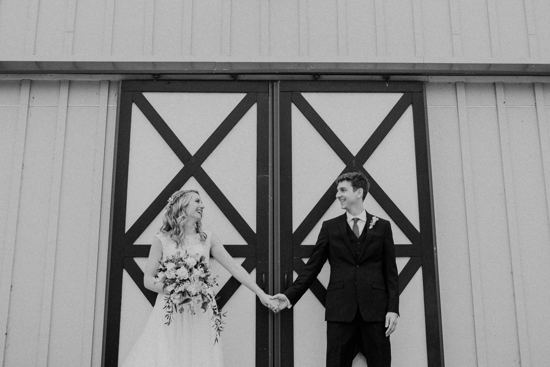 shadow creek barn doors wedding couple