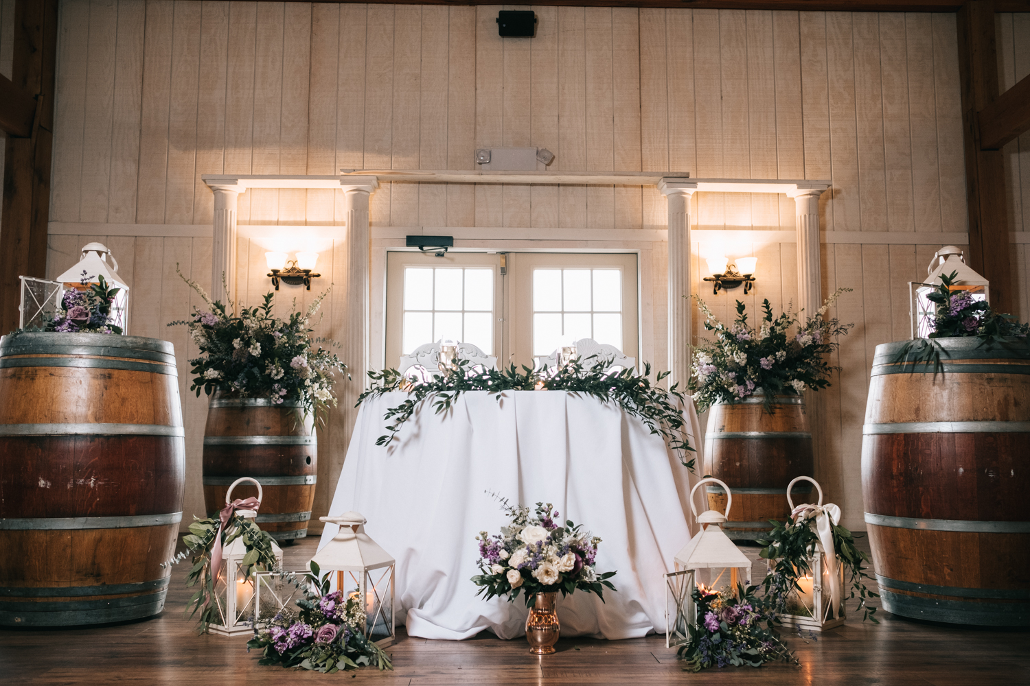 barn wedding bride and groom table design flowers