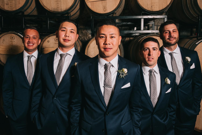 wine barrel groomsmen portraits