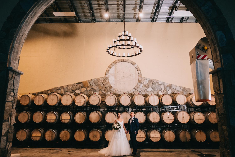 blue valley winery and vineyard wine barrel wedding portraits