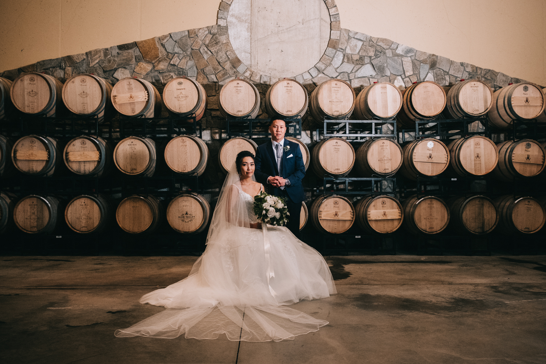 classy winery wine barrel wedding couple
