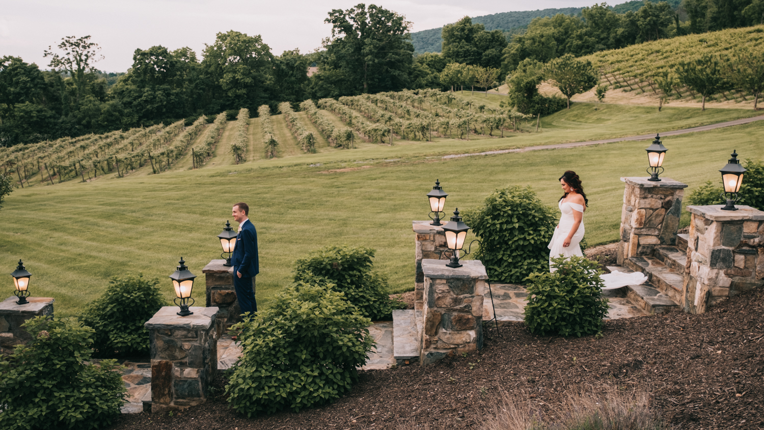 the stables at bluemont vineyard wedding first look on steps