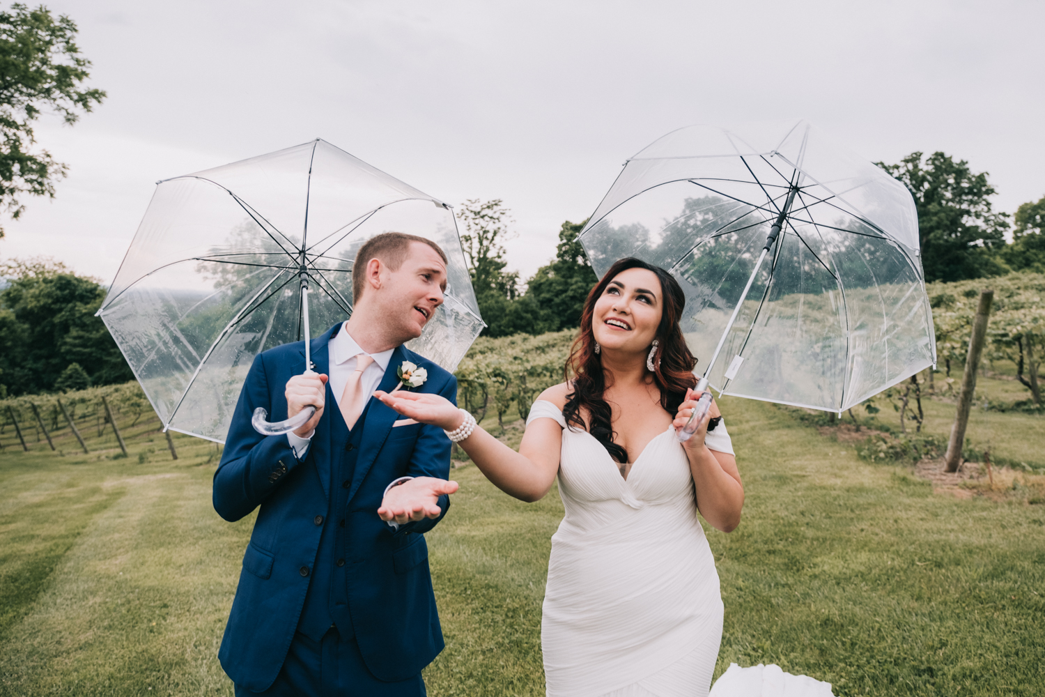 bluemont vineyard wedding rainy day umbrellas not a care in the world
