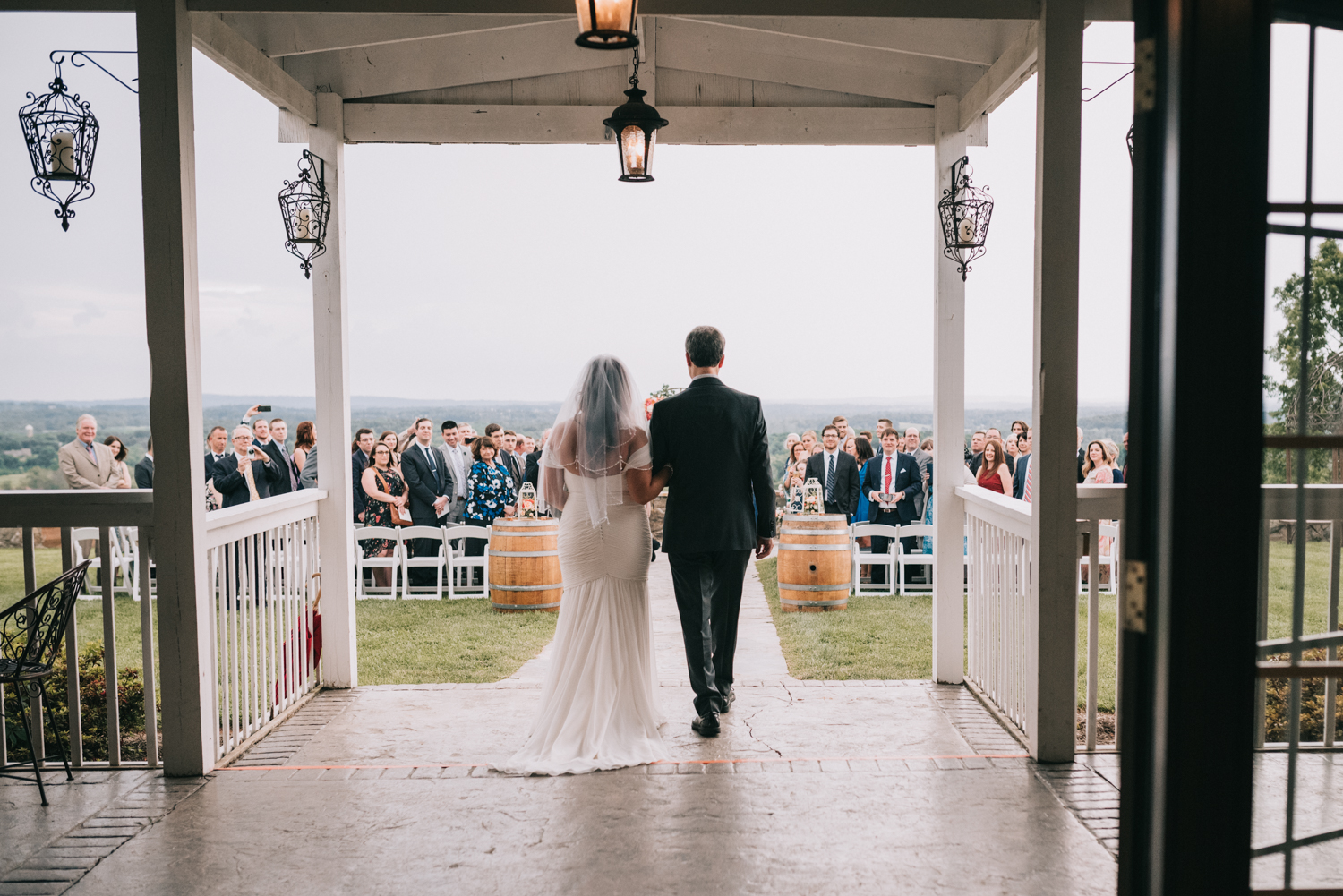 bride and father walk down the aisle at the stables at bluemont vineyard