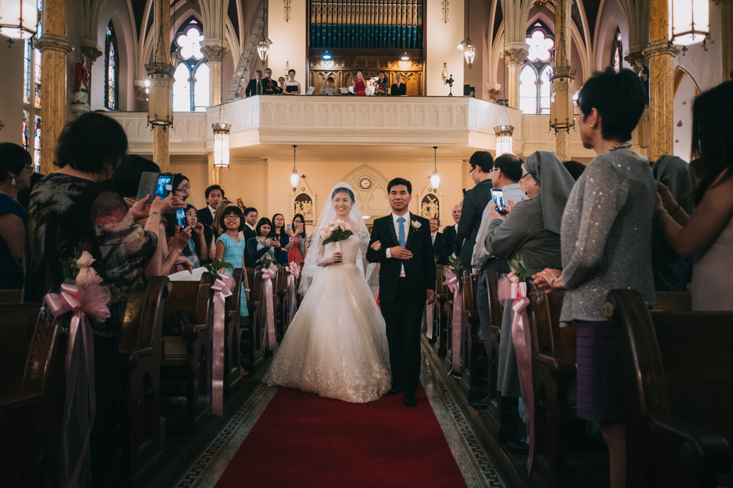 Bride walking down the aisle at St Mary Mother of God Catholic Church