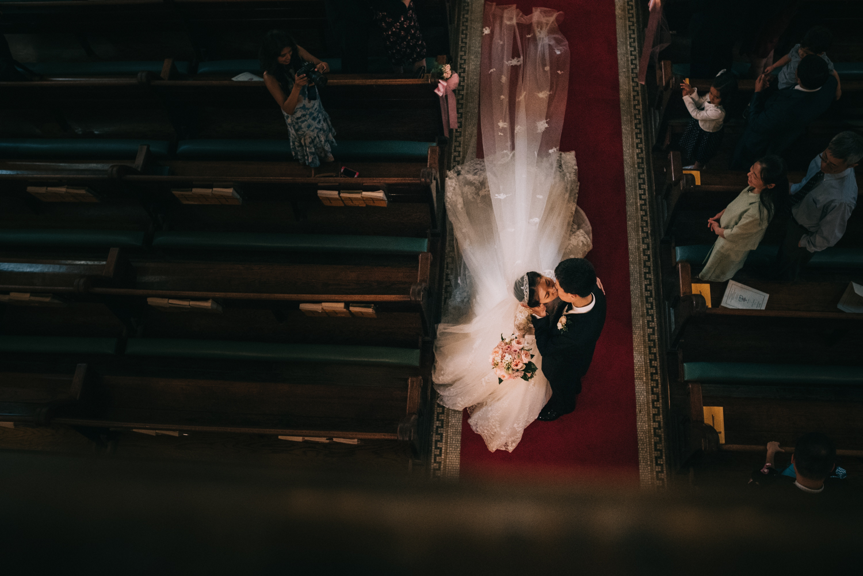 DC Wedding new married kiss walking up the aisle Catholic wedding