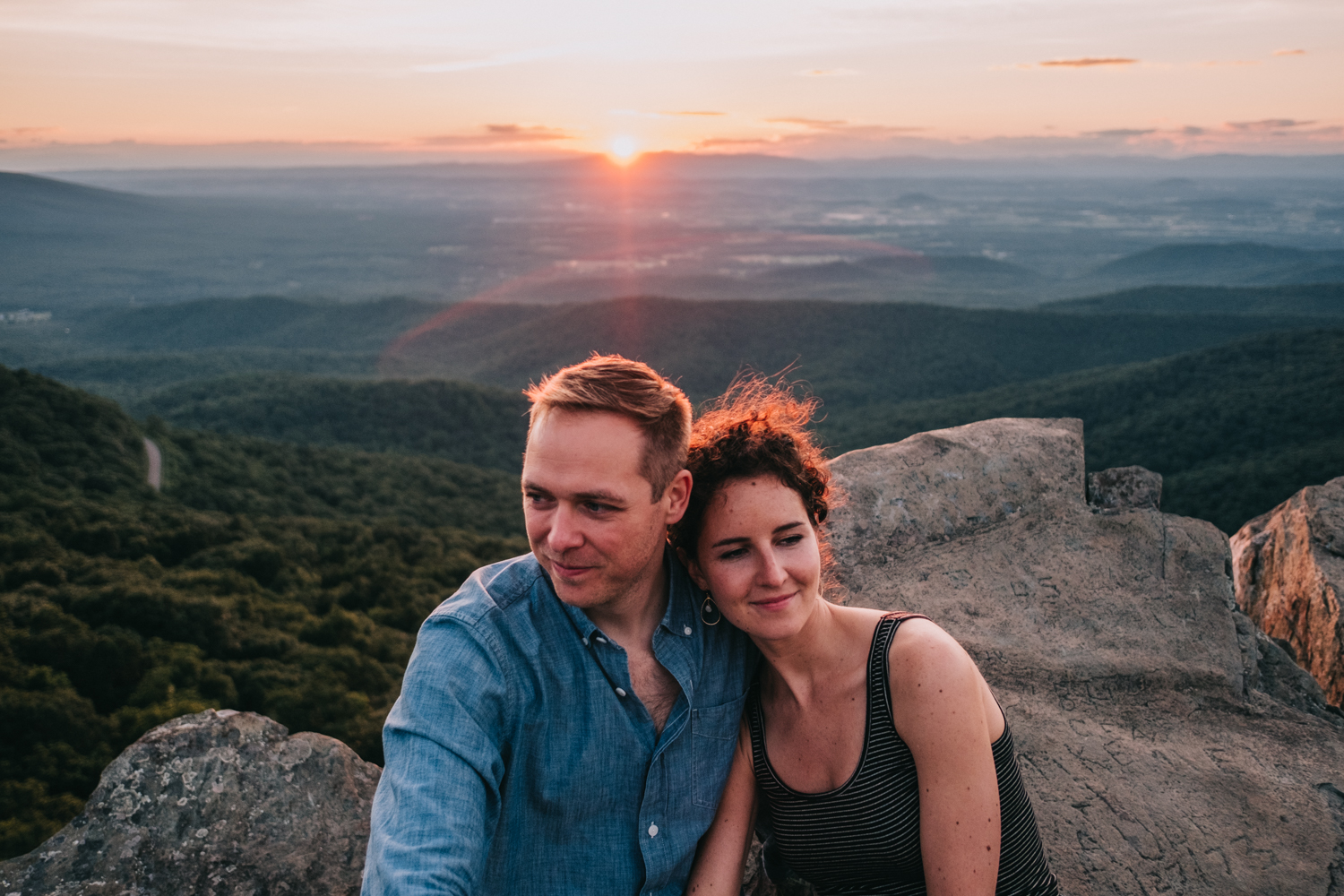 cuddling couple at sunset in the shenandoah mountains national parks