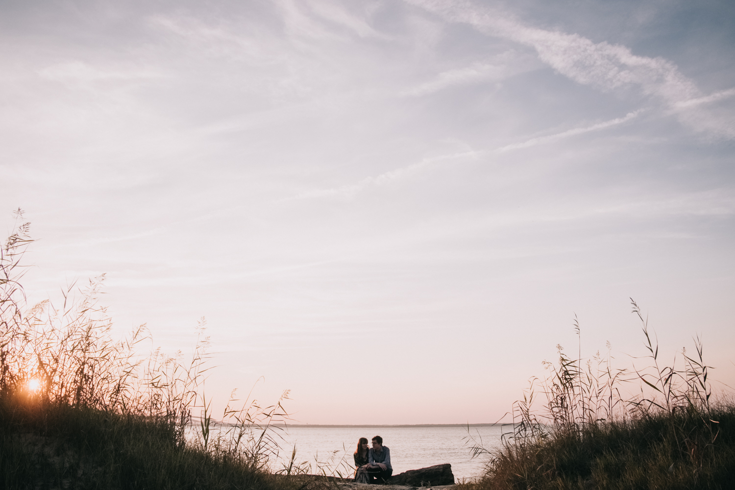 Sunset engagement photos at Terrapin Nature Park on the Bay