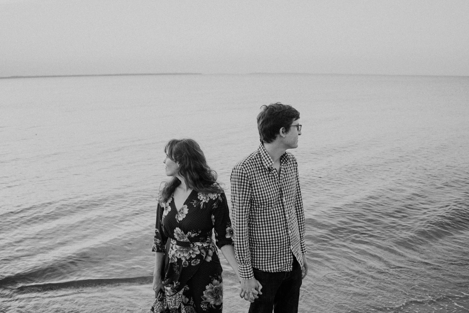 maryland chesapeake bay moody black and white engagement photos on the water