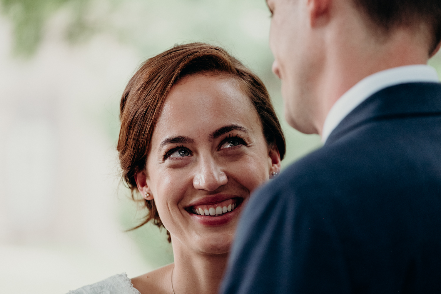 bride watches groom during wedding vows