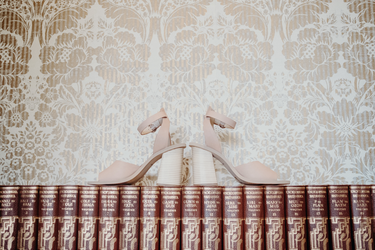 wedding inspiration bride shoes on old books