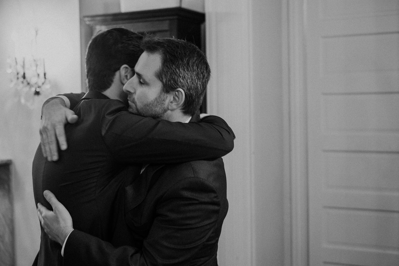 groom and brother hug before wedding