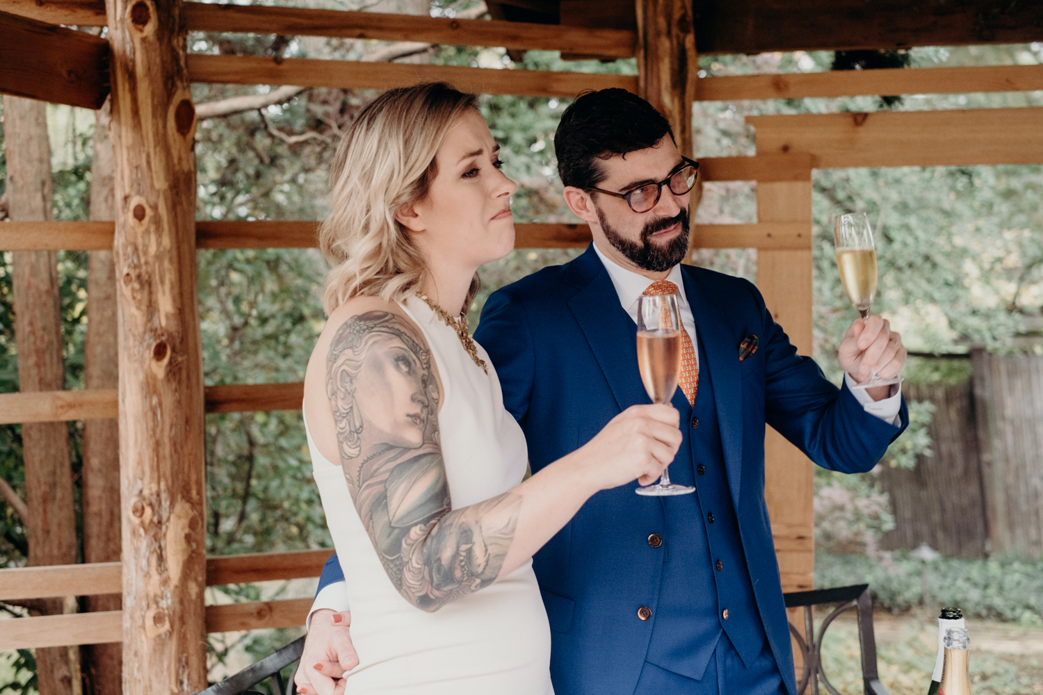 bride and groom toasts at tudor place gardens